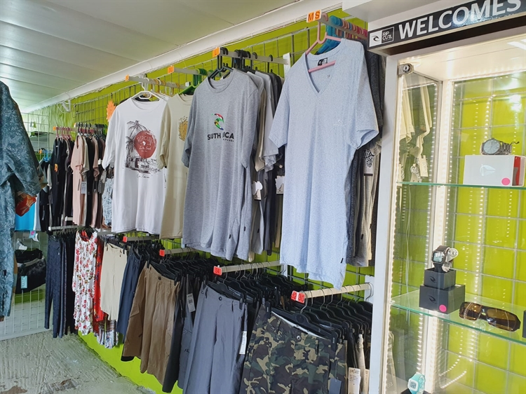 fully stocked surf shop - 7